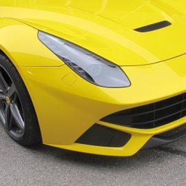 Ferrari F12 Berlinetta, gelb und Carbon-Strukturfolie, Front